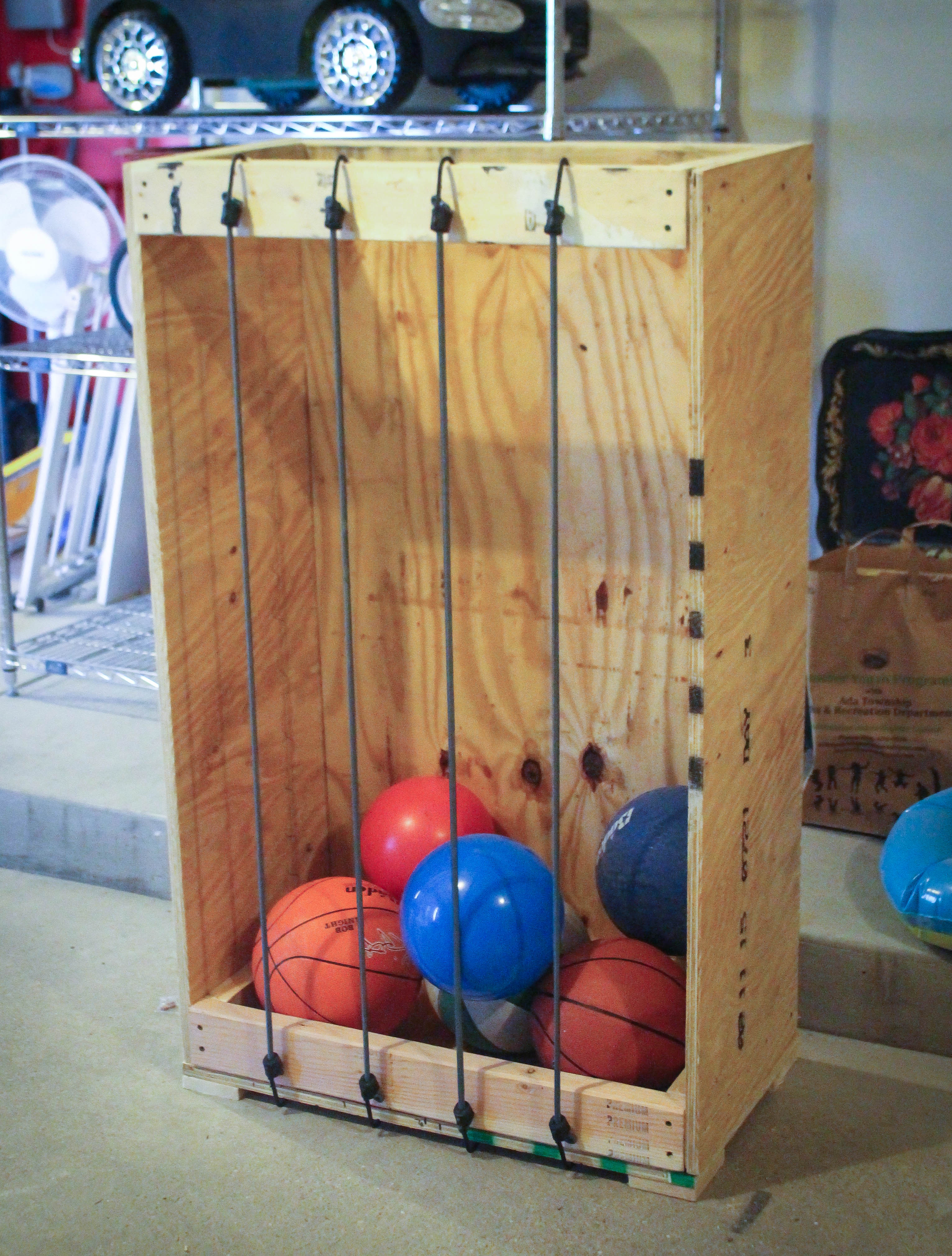 ball storage. oh wait\u2026crap. i made it way too big. mean\u2026it seriously looks like a joke. after some brainstorming cut and added shelf. perfect! ball storage s